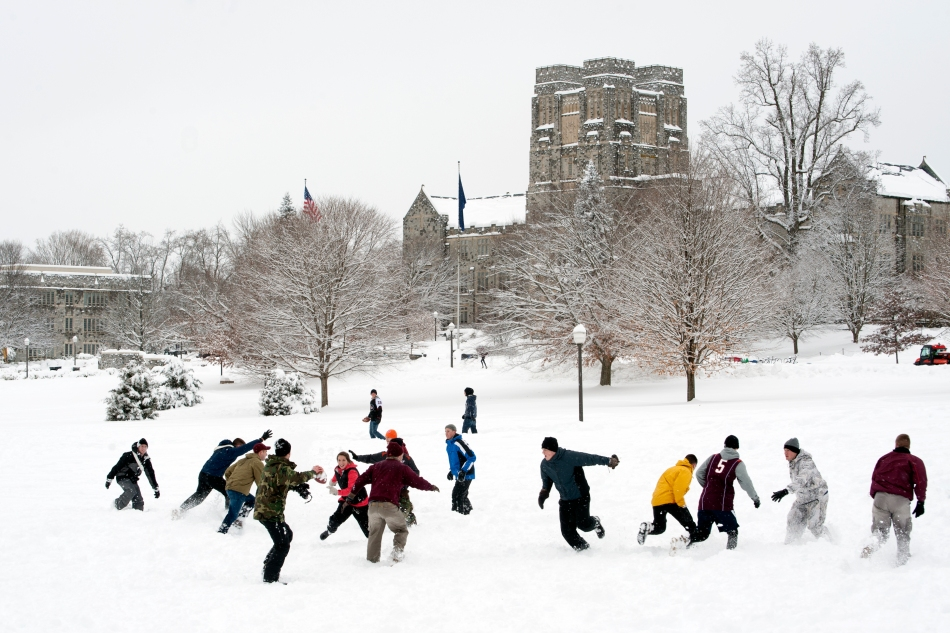 Students play football on Virginia Tech's drillfield after classes were cancelled on February 13 due to a record 19 inches of snow overnight.